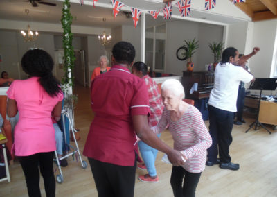 Care Home staff and residents dancing together to live music