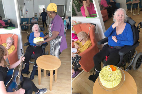 Lady resident being surprised with her birthday cake at Bromley Park Care Home