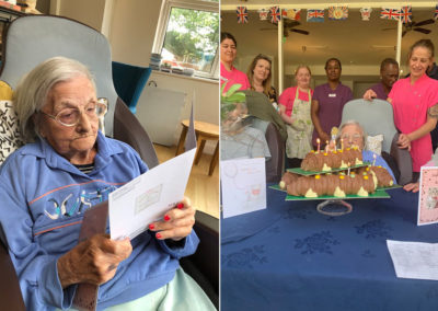 Resident opening cards on her birthday at Bromley Park