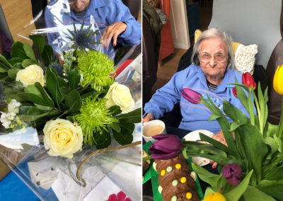 Resident with her birthday flowers at Bromley Park