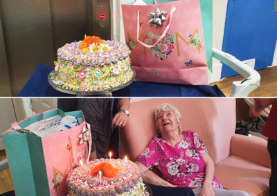 Lady resident with her cake and gift bag at Bromley Park Care Home