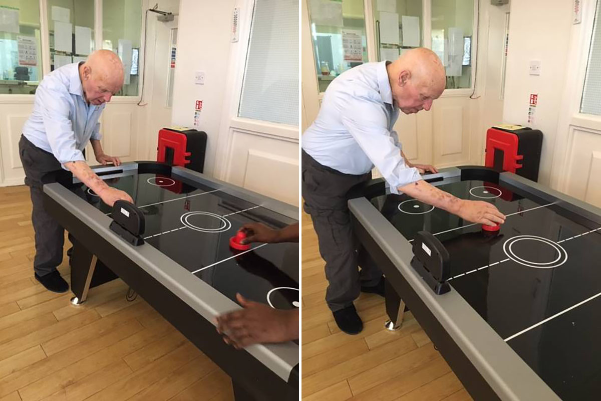 Bromley Park Care Home resident tests his air hockey skills