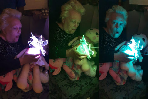 Resident with her unicorn lamp, lit up in the dark