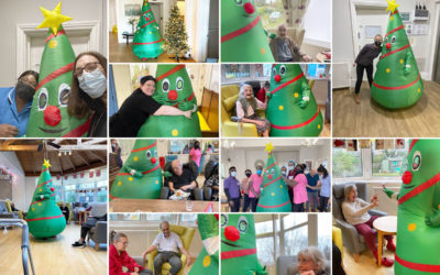 Staff member dressed up as a Christmas tree, with staff and residents at Bromley Park Care Home