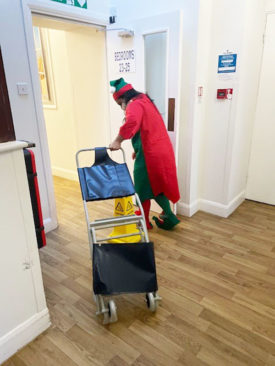 Staff member dressed as a cheeky Christmas elf at Bromley Park Care Home