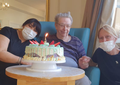 A staff member and resident with his birthday cake at Bromley Park Care Home